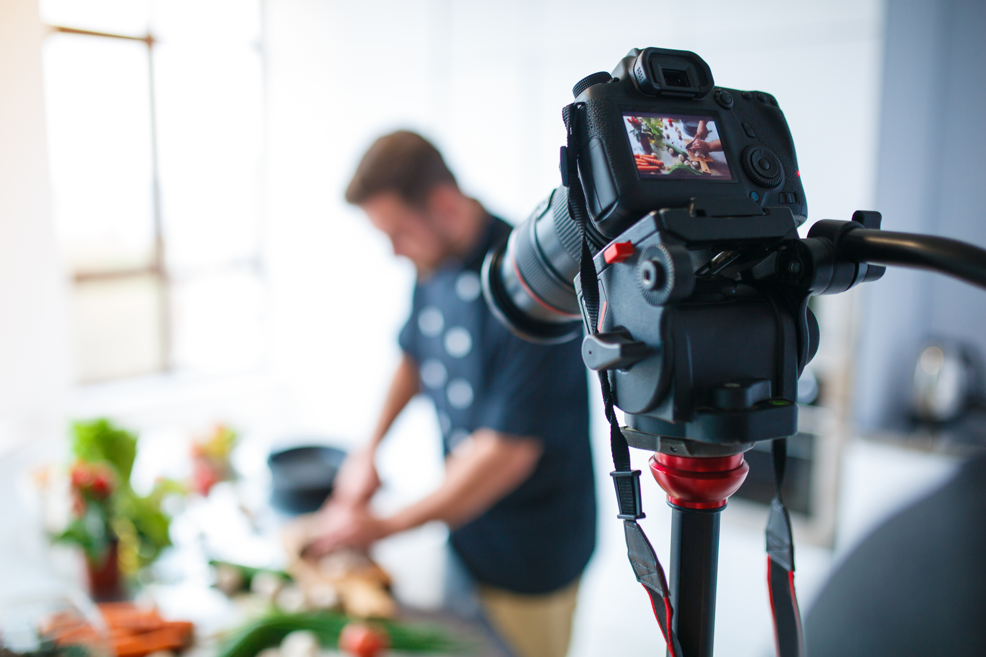 The camera takes off the cooking process in the kitchen of a European brunette man.